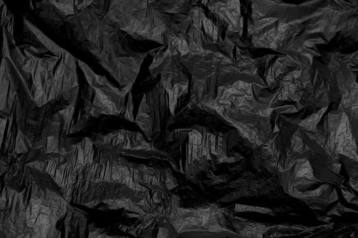 Black wrinkled plastic for background and texture. Trash Abstract Backdrop Backgrounds Black Black Plastic Blank Close-up Creases Crumpled Crumpled Paper Crushed Full Frame Gabage Indoors  Linen No People Paper Pattern Plant Part Recycle Bag Sheet Textured  Wallpaper Wrinkled