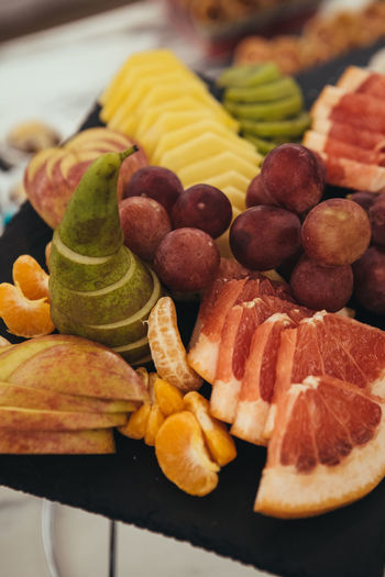 Catering Food - Fruits Catering Choice Citrus Fruit Close-up Focus On Foreground Food Food And Drink Freshness Fruit Fruits Healthy Eating High Angle View Indoors  Meat No People Plate Ready-to-eat SLICE Snack Still Life Sweet Food Table Temptation Variation Wellbeing