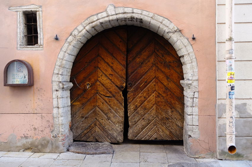 Ancient Wooden Door Ancient Estonia Gate Tallinn Travel Photography Arch Architecture Building Building Exterior Built Structure Closed Day Door Entrance Gate History Lopsided No People Old Outdoors Portal Travel Destination Travel Destinations Wooden Door