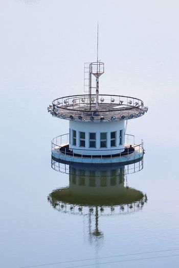 Water Reflection Architecture Sky No People Building Exterior Built Structure Lake Mode Of Transportation Nautical Vessel Outdoors Nature Transportation Tower Waterfront Clear Sky Day Building