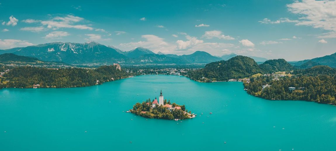 Lake Bled, Slovenia - Drone Shot #2 Water Scenics - Nature Beauty In Nature Mountain Sky Tranquil Scene Nature Tranquility Cloud - Sky No People Sea Waterfront Mountain Range Day Idyllic Outdoors Non-urban Scene Travel Destinations Nautical Vessel Turquoise Colored Bay Drone  Bled Slovenia Dronephotography
