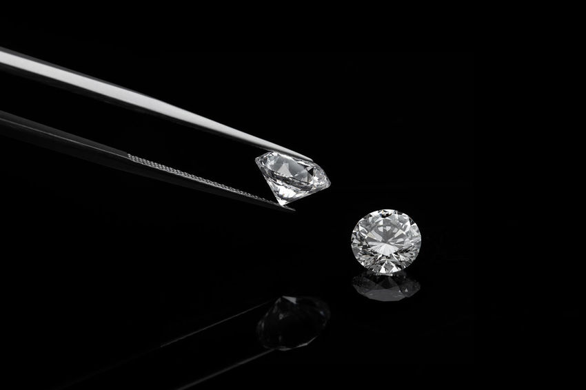 loose brilliant diamonds, one is being held by a tweezers on reflective black background BIG Carat D Diamond Expensive Facet Fine Gemology Grading Grey Held Inspecting Isolated Loose Polish Reflected  Round Selling Shape Sorting  Square Tongs Trading Tweezers White