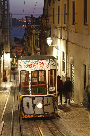 Elevador da Bica at Dusk, Lisbon, Portugal Architecture Building Exterior Built Structure City Day Elevador Glorious Illuminated Lisbon Lissabon Night Outdoors People Standseilbahn Street Tramcar Tranquility Travel Destinations Women