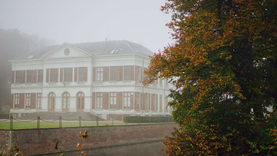 Architecture Building Exterior Tree Built Structure Growth No People Outdoors House Day Grass Sky Nature Landscape Foggy Weather SONY A7ii Tranquil Scene Foggy Day Misty Morning Mist Foggy Architecture Photography Park Fog Foggy Morning Misty