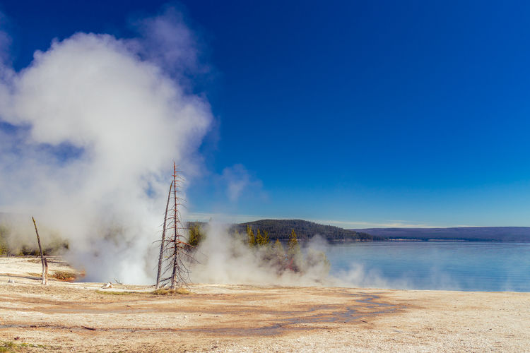 West thumb geyser basin against clear blue sky at yellowstone national park