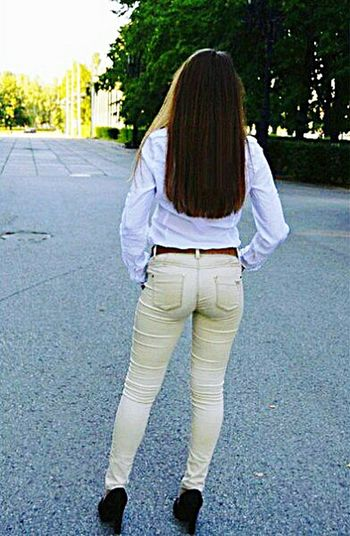 Rear View Long Hair Road Transportation Casual Clothing Person Tree Lifestyles Leisure Activity The Way Forward Country Road Countryside Day Solitude Outdoors Medium Length Hair Remote Straight Hair Tranquil Scene