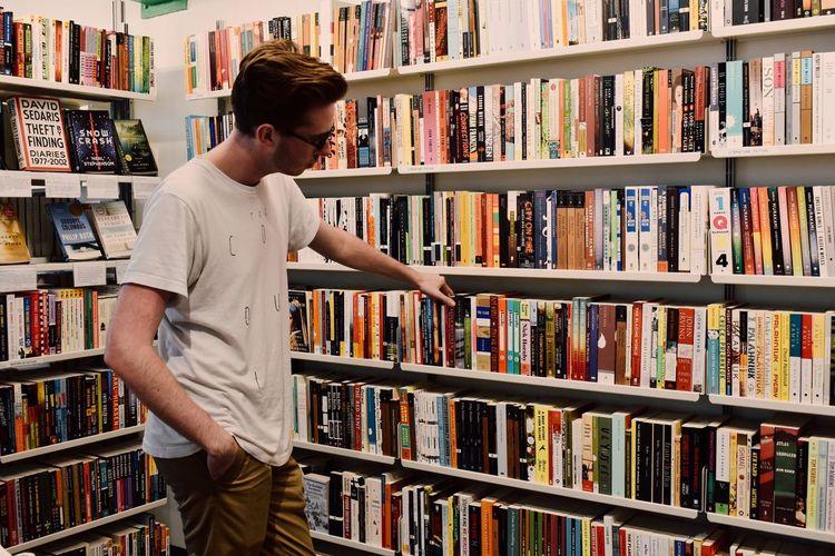 Full length of man standing on book