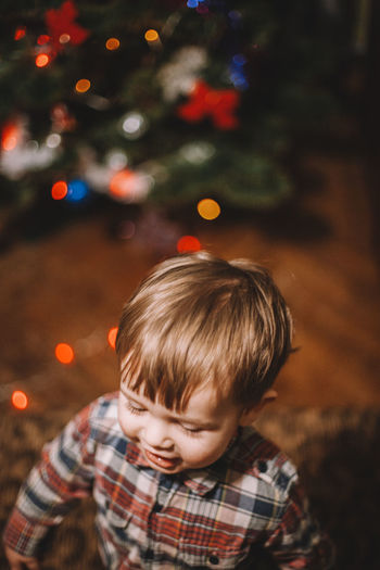 Close-Up Of Cute Boy At Home During Christmas