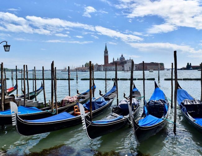 Venetian Gondolas Mode Of Transport Moored Architecture Transportation Water Sky Building Exterior Nautical Vessel Built Structure Cloud - Sky Day Wooden Post Waterfront Gondola Spirituality No People Travel Destinations Outdoors Place Of Worship Gondola - Traditional Boat Gondola