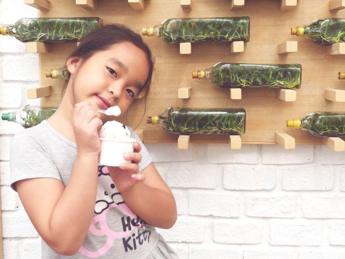 Portrait of girl having ice cream in restaurant