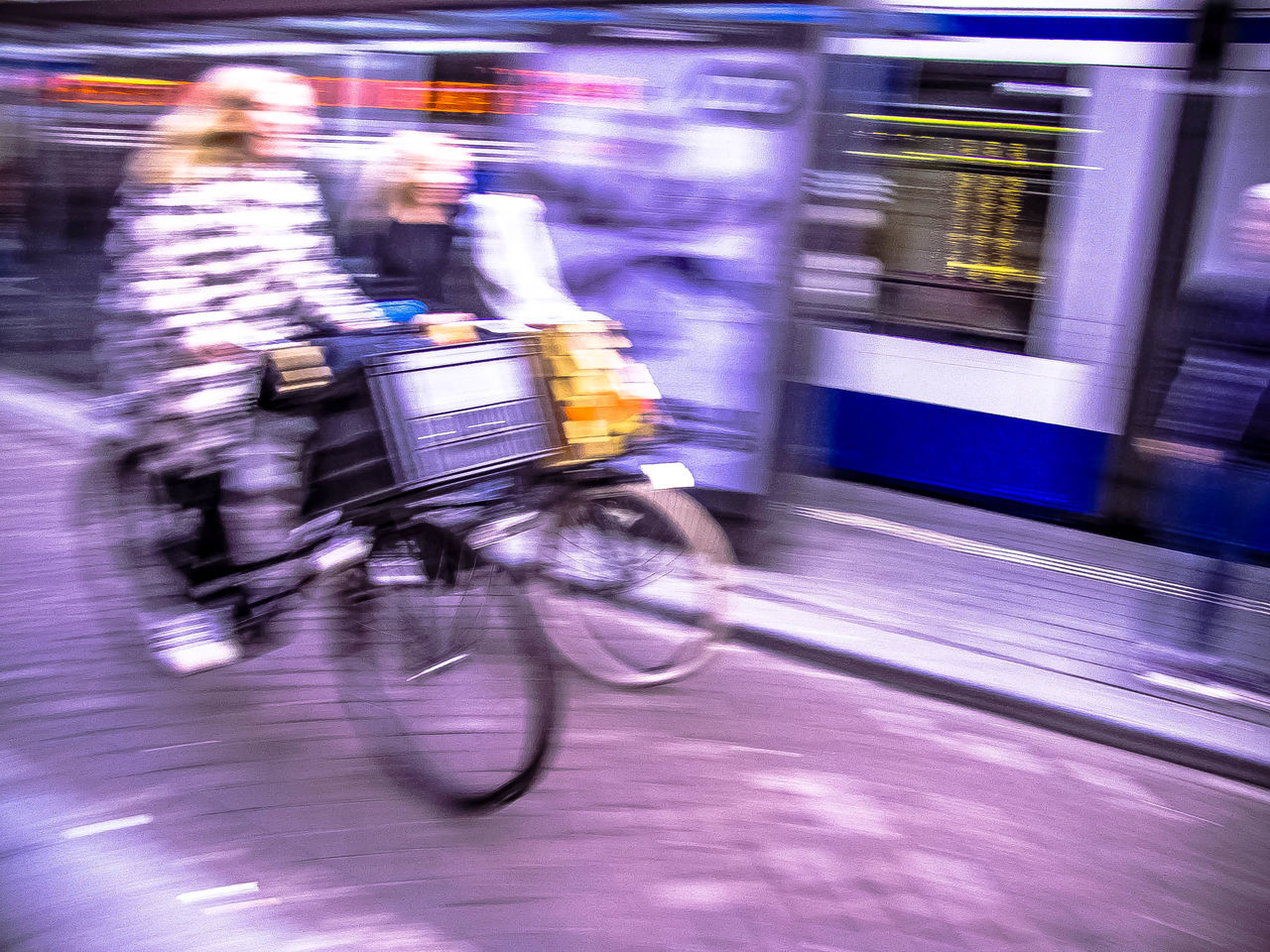 blurred motion, speed, motion, transportation, mode of transport, long exposure, bicycle, riding, public transportation, urgency, defocused, illuminated, outdoors, people, adult, city, one person, day