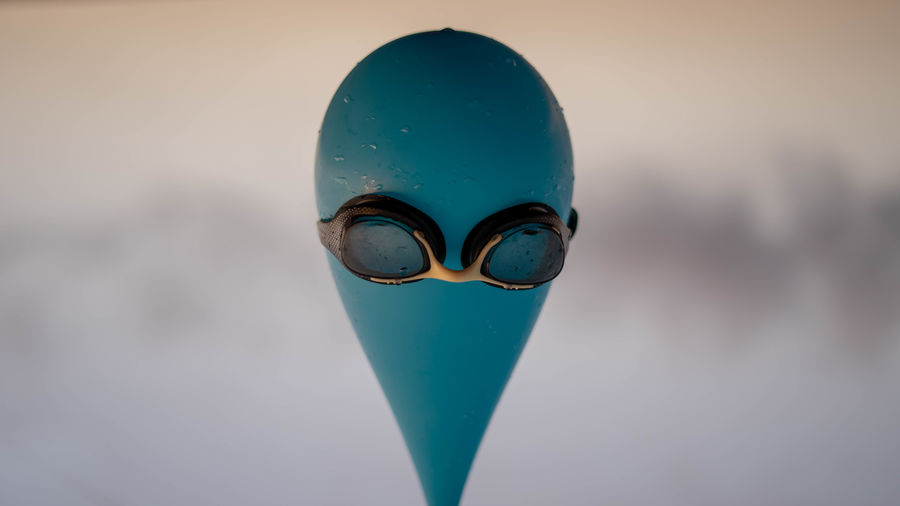 Close-up of swimming goggles on balloon