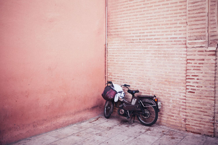 Architecture Brick Brick Wall Building Building Exterior Built Structure City Day Door Entrance Footpath Land Vehicle Mode Of Transportation Motorcycle No People Outdoors Scooter Transportation Wall Wall - Building Feature