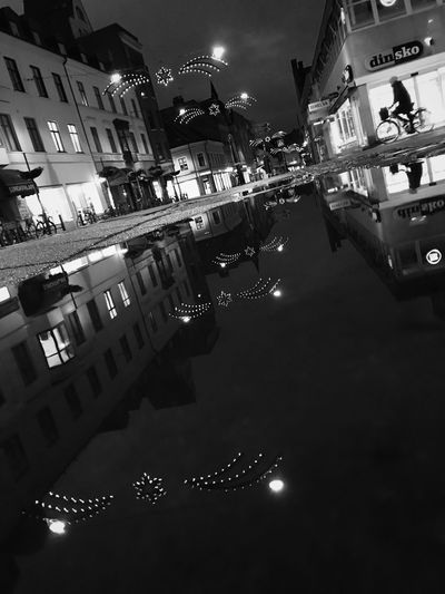We are all in the gutter, but some of us are looking at the stars. Architecture Building Exterior Built Structure Night Illuminated City Reflection Outdoors Street Sky Street Light Water