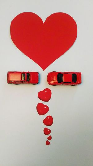 Valentine's day Love Yourself Mini Cars Still Life Symbiotic Relationship Conceptual Be Mine Toys Heart Shape Love Red Valentine's Day - Holiday Indoors  Studio Shot No People White Background Close-up Day Indoors