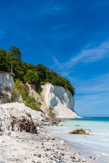 Baltic Sea coast on the island Ruegen, Germany. Baltic Sea Chalk Cliffs Holiday Relaxing Sassnitz Beach Beauty In Nature Clouds And Sky Coast Day Horizon Over Water Nature No People Outdoors Ruegen Scenics Sea Shore Sky Tourism Tranquil Scene Travel Destinations Vacation Water White Cliffs