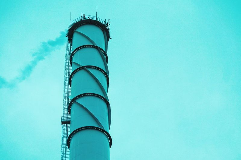 Chimney Green Color Green Turquoise Colored Architecture_collection Architectural Column Architecture Smoke Chimney Low Angle View Blue No People Copy Space Built Structure Architecture Metal Turquoise Colored Clear Sky Sky Tower Blue Background