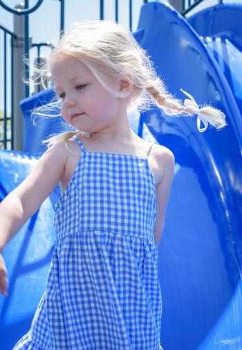 Girl looking at swimming pool