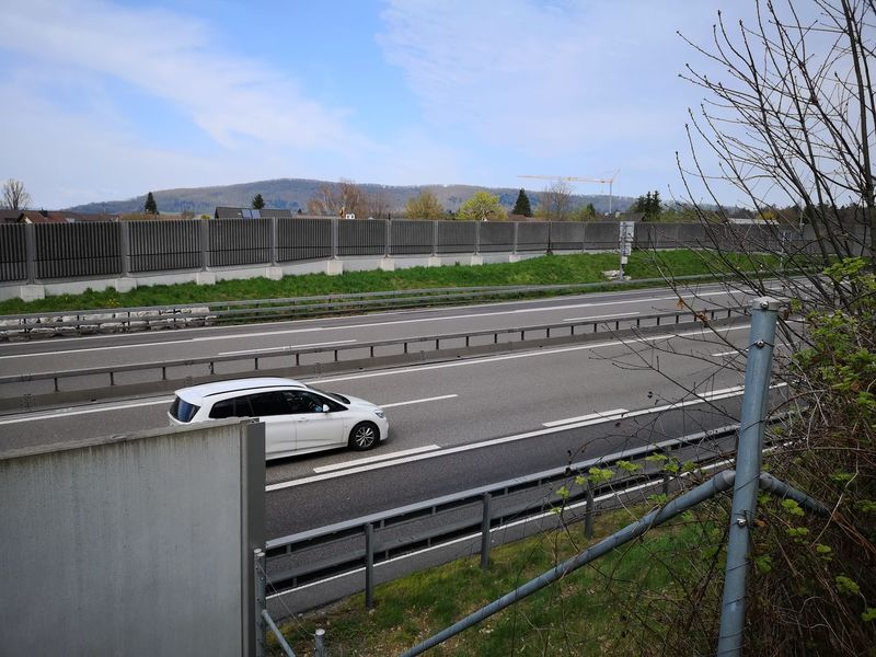 White car driving on the A1 motorway in Switzerland towards Zurich. Traffic No Traffic Little Traffic Tranquil Scene Tranquility White Car Driving Motorway Highway A1 Switzerland Towards Zürich Zürich Niederlenz Noise Protection Wall Sky Fence