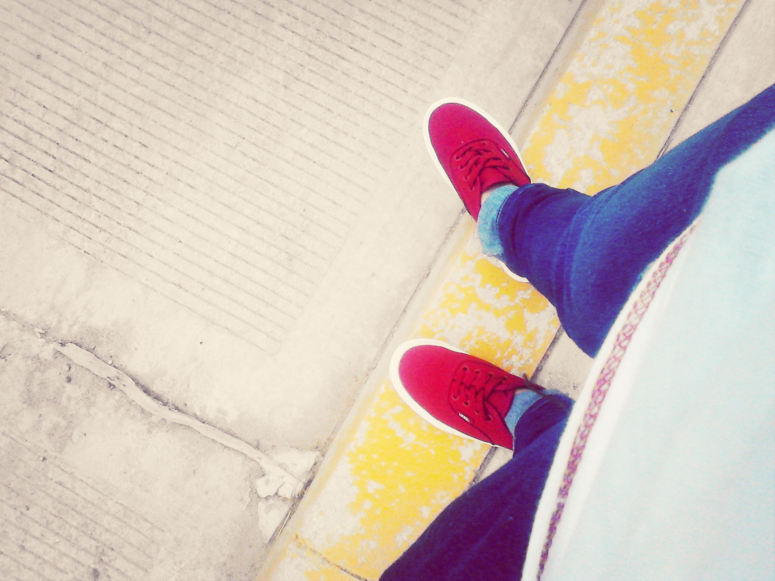 low section, person, personal perspective, shoe, lifestyles, yellow, indoors, high angle view, human foot, part of, leisure activity, footwear, red, standing, unrecognizable person, jeans