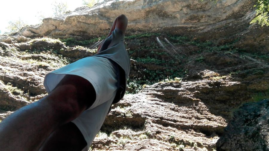Person Low Section Relaxation Personal Perspective Close-up Rock Formation Outdoors Resting Day Rock Tranquility Mountain Valley MC* Non Urban Scene Long Solitude