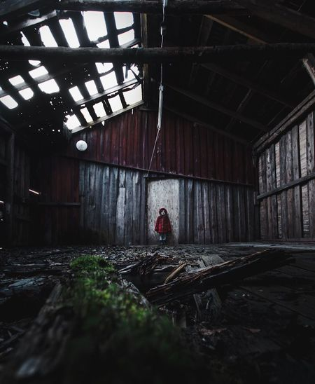 Woman in abandoned building
