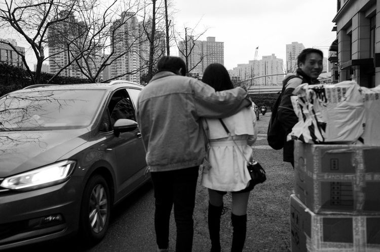 Real People Mode Of Transportation Motor Vehicle Men Car Transportation Architecture Built Structure City Building Exterior Women Lifestyles Land Vehicle Rear View Group Of People Child Adult Street Togetherness Full Length Teenager Streetphotography Blackandwhite Lovely