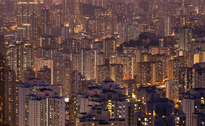 High angle view of skyscraper and high-rise buildings in hong kong. night city.
