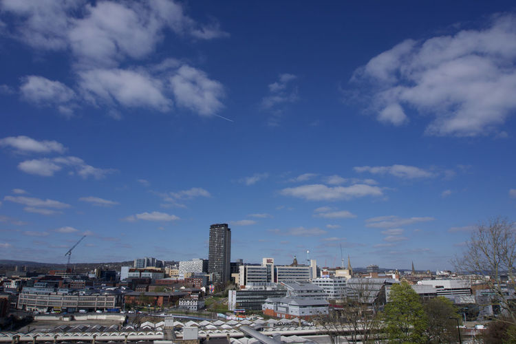 View across Sheffield City Centre from park Hill Sheffield Architecture Built Structure Building Exterior Sky Cloud - Sky City Building Nature Day Residential District No People Cityscape Blue Outdoors City Life Office Building Exterior Industry Tree Plant Skyscraper