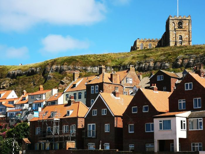 Whitby North Yorkshire Yorkshire Whitby Abbey Abbey Church Churches Church Tower Church Buildings Cliff Cliffs Cliffside EyeEm Selects Cityscape City Clock Clock Tower History Blue House Old Town Sky Architecture Townhouse Bell Tower - Tower Town Tiled Roof  Rooftop TOWNSCAPE Medieval Bell Tower