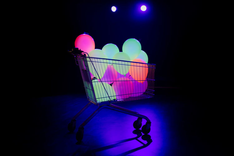 Black Background Buying Consumerism Dark Glow Glowing Glowing In The Dark No People Retail  Shopping Cart Studio Shot Supermarket Ultraviolet Light Yellow