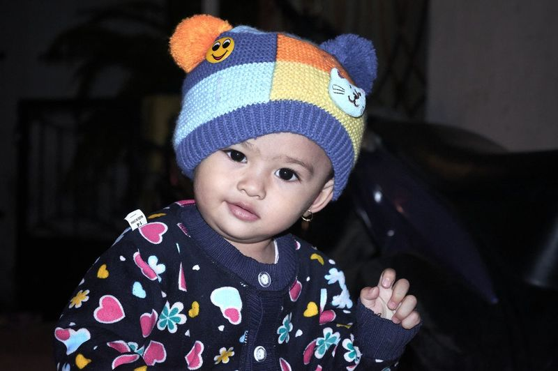 ISO 3200 1/60 s f/5.6 55 mm +Flash Bandung Shooter Indonesian Shooter Childhood Child Portrait Innocence One Person Clothing Front View Headshot Knit Hat Cute Looking At Camera Hat Real People Smiling Close-up Baby Offspring Focus On Foreground Indoors