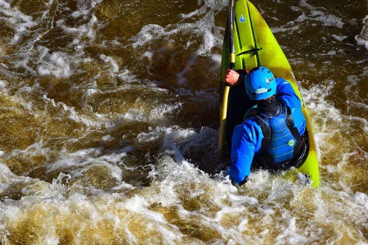 Man surfing in river