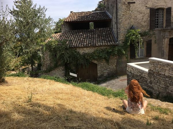 Idyllic Scenery Building Exterior Built Structure Architecture Lifestyles Day One Person Women Outdoors Sitting Tree Real People Young Women Nature Grass Beauty In Nature Young Adult People Only Women Adult One Woman Only