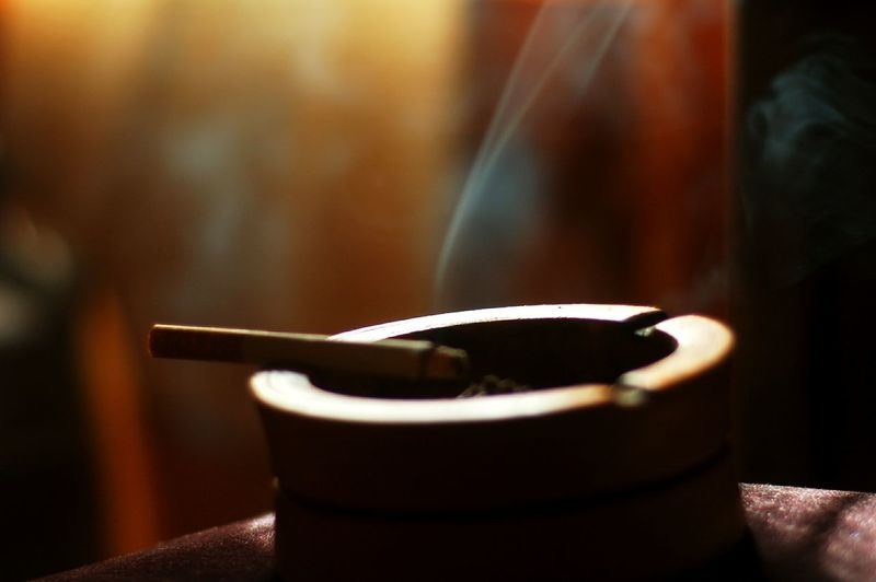 Burning Cigarette In Ash Tray