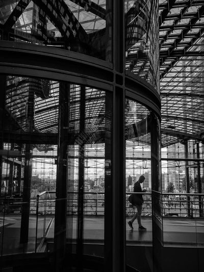 Glass - Material Architecture Window Built Structure Indoors  Reflection Modern Real People City Travel Station EyeEm Awards 2017 Travel Destinations Modern Architecture Black & White Black And White Monochrome Bnw Blackandwhite Photography Architecture Light And Shadow One Person