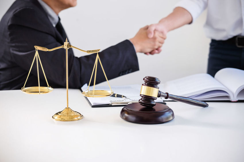 Collaboration Lawyer Shaking Adult Barrister Business Business Person Businessman Fairness Focus On Foreground Formalwear Hand Handshake Holding Human Body Part Indoors  Judge Judgement Legal Men Occupation Office People Shaking Hands Standing