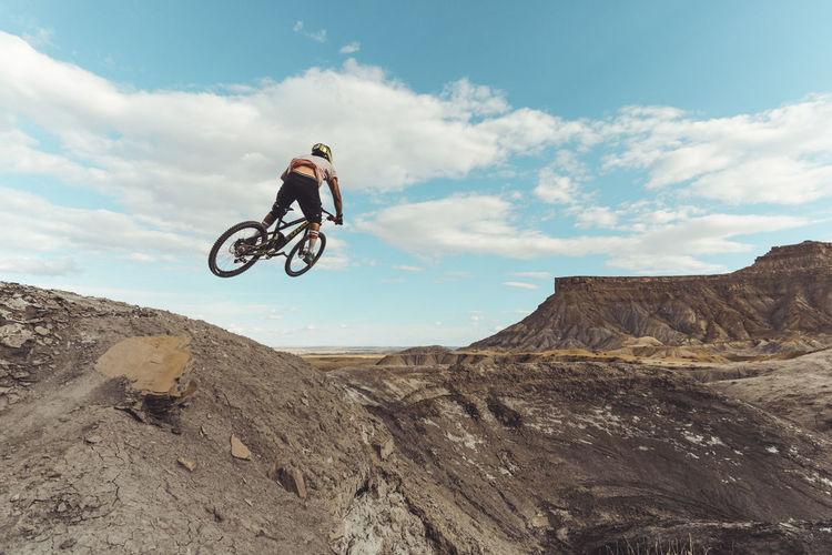 Man riding bicycle on rock