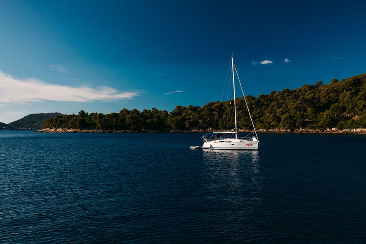 Boatlife Beauty In Nature Blue Boat Boatlife Croatia Mast Mode Of Transport Moored Nature Nautical Vessel No People Outdoors Sailboat Sailing Sailing Ship Scenics Sea Sky Tranquil Scene Tranquility Transportation Water Waterfront Yacht