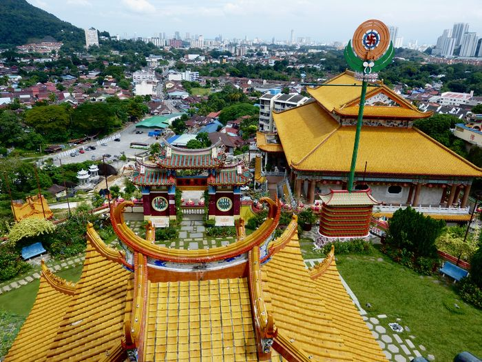 Reflection Rooftop Architecture Building Building Exterior Built Structure Chinese Temple City City Life Cityscape Day High Angle View Looking Far Nature No People Outdoors Panorama View Penang Malaysia Place Of Interest Plant Religion Residential District Roof Sky Travel Destinations