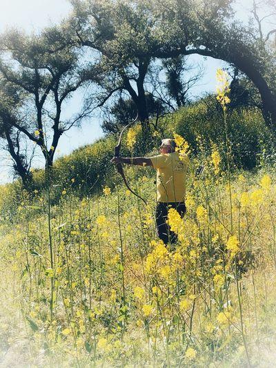 Shadow of man on yellow flower field