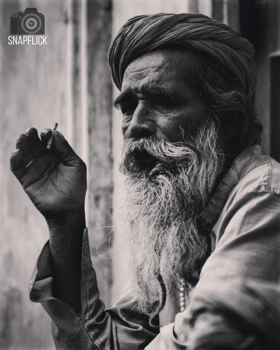 An old man smoking weed Beard Blackandwhite Monochromatic Monochrome Snapflick Street Street Photography Streetphotography Weed Weed Life First Eyeem Photo