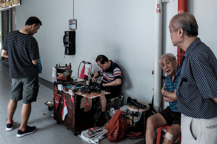 Dying trade. Shoe Cobbler Roadside Neighborhood Residential District Void Deck HDB Flats Corridor Old People Singapore Old Man North Bridge Road Dying Trade Street Photography Streetphotography Street Life Streetphoto_color Housing Estate FUJIFILM X100S