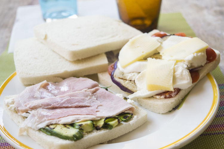 sandwiches filled with vegetables and cooked ham Snack Cooked Filled Filling Food Food And Drink Ham Plate Sandwich Table