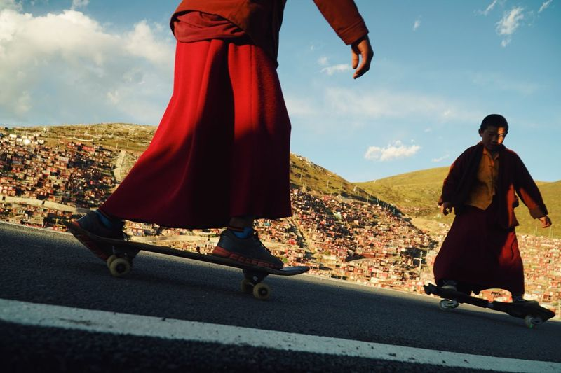 EyeEmNewHere Sky Two People Road Real People Day Outdoors Men Mountain Standing Leisure Activity Women Full Length Togetherness Nature Low Section Bride People Sport Monk  Skateboarding