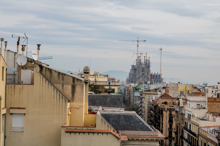 Sky Cityscape Travel Destinations Cloud - Sky City Architecture No People Outdoors Building Exterior Bridge - Man Made Structure Day Lifestyles Urban Skyline High Angle View Cityscape Portrait Of A City City Street Barcelona SPAIN Skyline Horizontal Sagrada Familia Watching Over A City Architecture Cityscapes