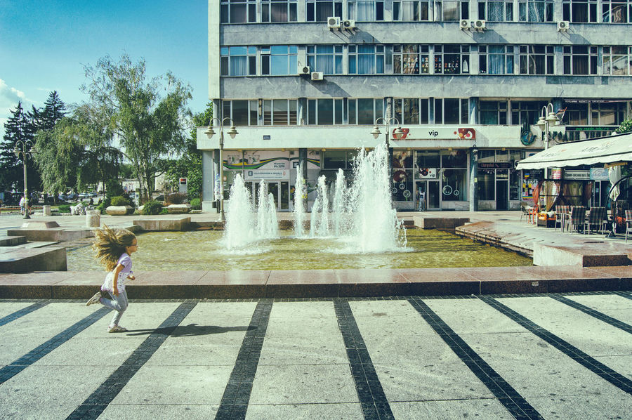 Architecture City City Center City Life Day Focus On Foreground Fountain Fun Happiness Little Girl Modern Smile Smile ✌ Summer Summer In The City Summertime Water