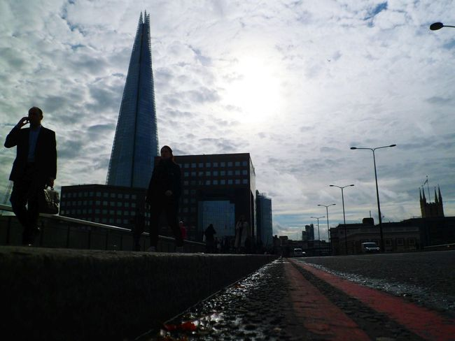 Down low with the shadow people Architecture Connection Structure Transportation London Outdoors Sky Low Angle View Lines Bridges People Seeing The Sights Incidental People Famous Place Travel Destinations Capital City Capital Cities  Travel Shard London Bridge Cloud - Sky Tall - High International Landmark Skyscraper