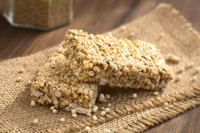 Granola or cereal bars made of popped quinoa, sesame seed, popped rice, sunflower seed, chia and honey, photographed with natural light (Selective Focus, Focus on the front edge of the upper bar) Cereal Chia Quinoa Rice Seed Bar Cereal Bar Food Food And Drink Granola Granola Bar Healthy Healthy Eating Honey Popped Popped Quinoa Puffed Seed Sesame Snack Sunflower Seed Superfood Sweet Sweet Food Vegan