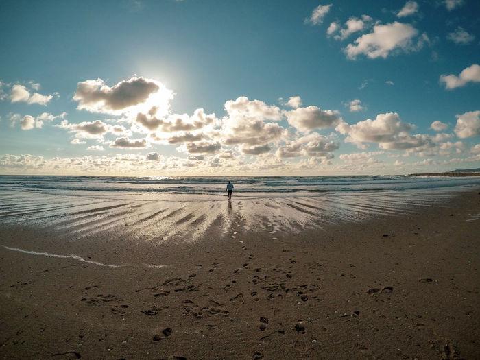 Walking on the beach Sunset Travel Water Sea Beach Sand Summer Beauty Sky Horizon Over Water Cloud - Sky Tide Shore Sandy Beach Wave Seascape Coastline Calm The Traveler - 2018 EyeEm Awards